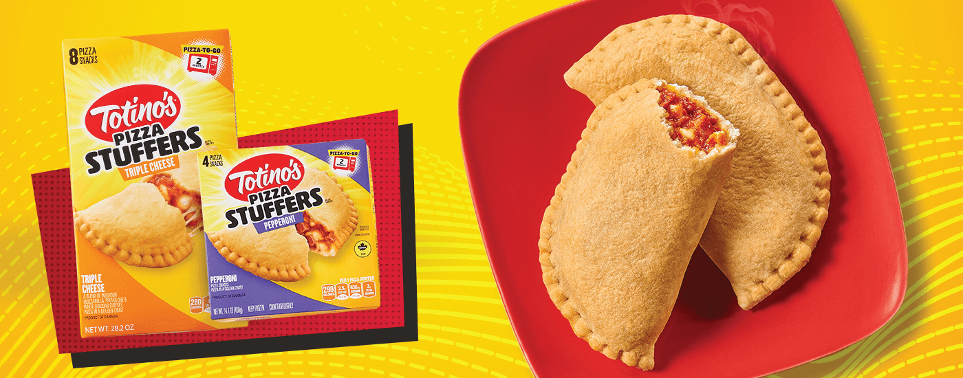 Two Totino's Pizza Stuffers on a plate opened to see the filling.